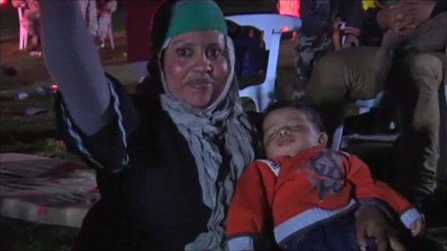 A Gaddafi loyalist and her child
