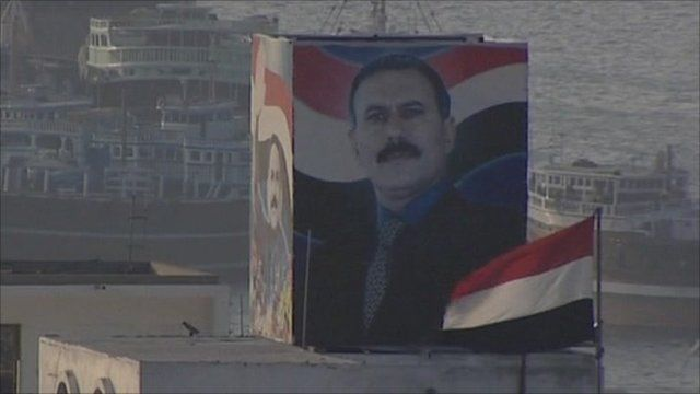 Building with picture of Ali Abdullah Saleh painted on side
