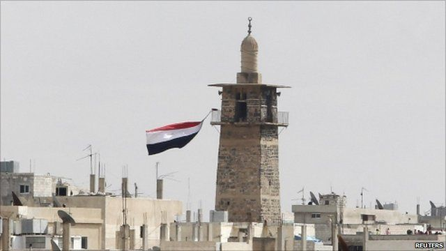 Syrian flag flying at Omari mosque