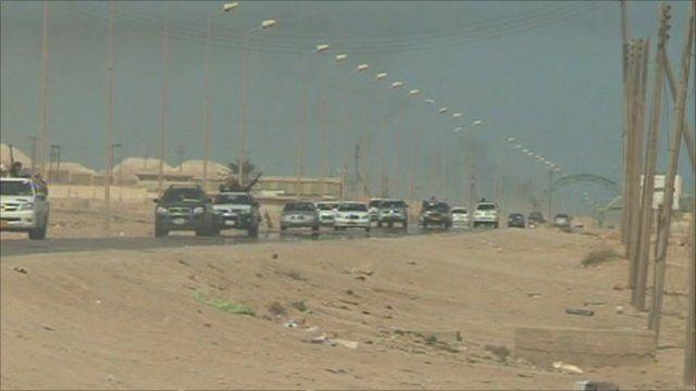 Rebels driving away from Bin Jawad
