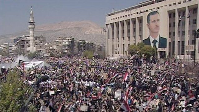 Thousands gather for a pro-Assad rally