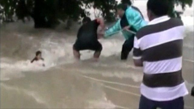 Man pulled from flood water in Thailand
