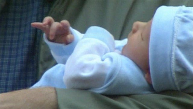 Baby Leo held by Tony Blair
