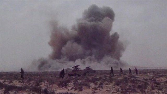 Plumes of smoke after the Nato attack on rebel forces