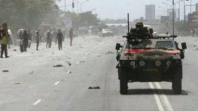 People and armoured vehicle in Abidjan, Ivory Coast