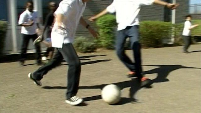 Visually impaired children playing football