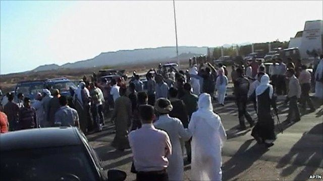 Protesters outside Mr Mubarak's hospital