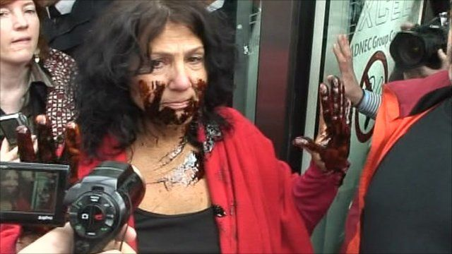 Diane Wilson covered her hands and face in dark syrup