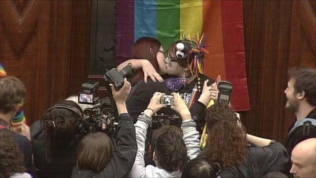 People kissing outside the pub
