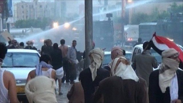 People flee the water cannon