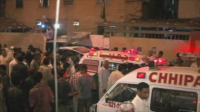 Emergency vehicles and crowds gathered outside the illegal gambling den after the explosion