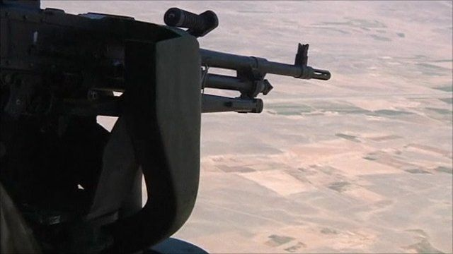 Rifle aimed out of helicopter