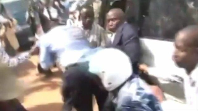 Police fight with Kizza Besigye and his supporters during his arrest