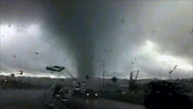 Tornado moving across a road