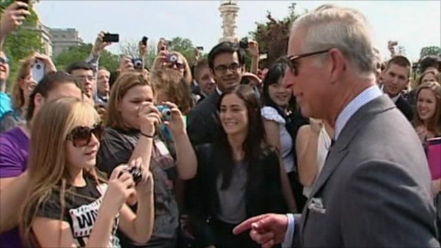 Students taking photos of Prince Charles