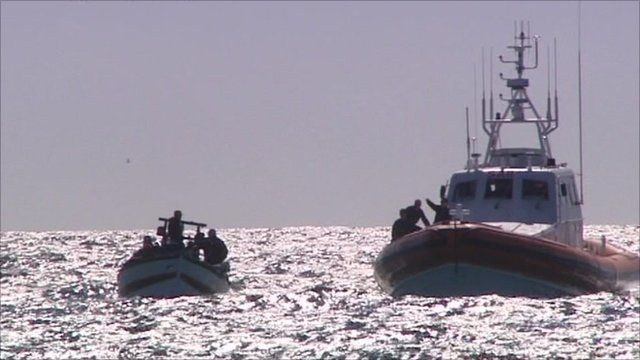 Boats hold migrants on sea