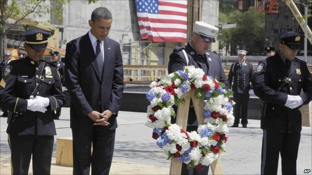 President Obama leading a minute silence
