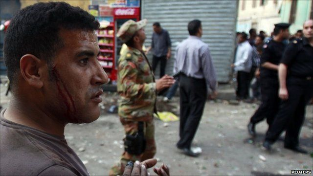 Injured Christian in Cairo street following clashes with Muslims