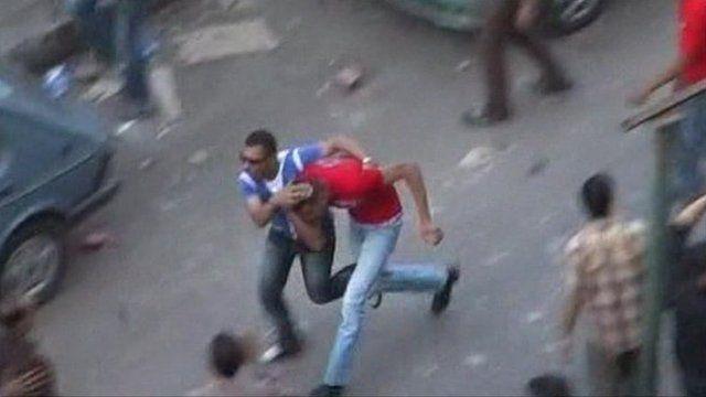Two men run through Cairo