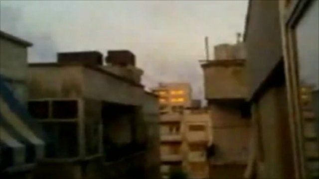 Amateur footage showing smoke over Homs