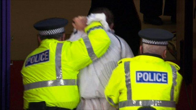 A man is led away by police in Tynecastle