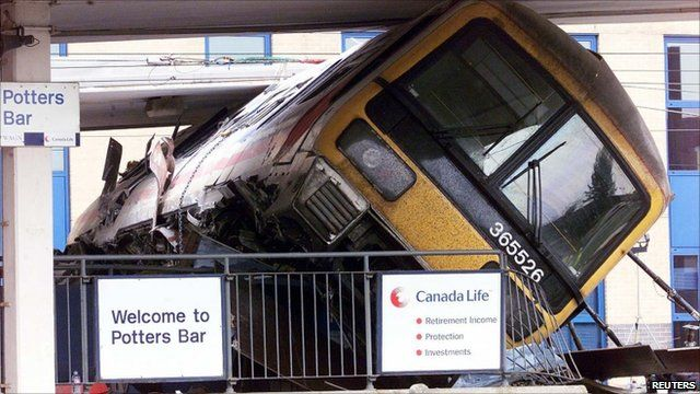 Train carriage wedged on the platform after crash