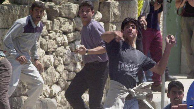 Ramallah protester throws stone