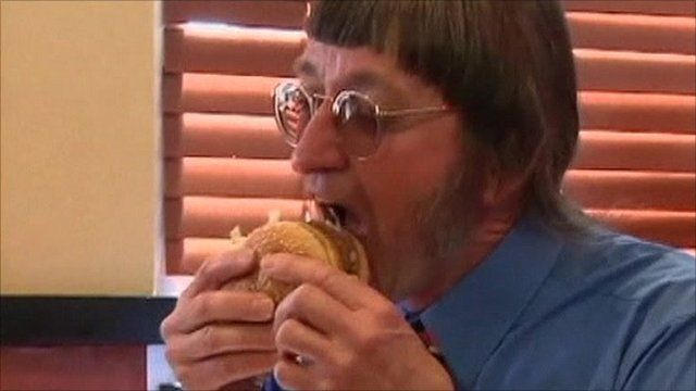 Don Gorske tucks in to his 25,000th burger