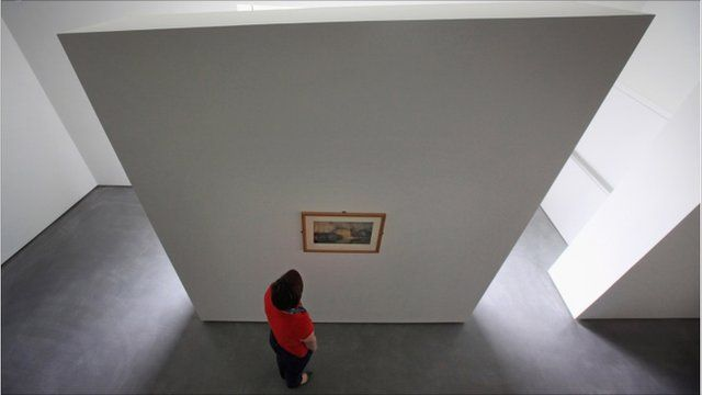 "A gallery assistant views JMW Turner""s Wakefield Bridge (circa 1798) in the new Hepworth Wakefield Gallery"