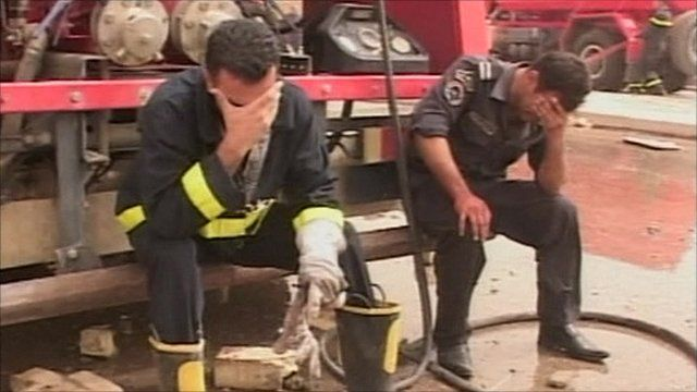 Fire fighter and policeman with heads in their hands