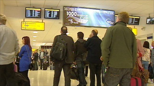 People looking at flight information