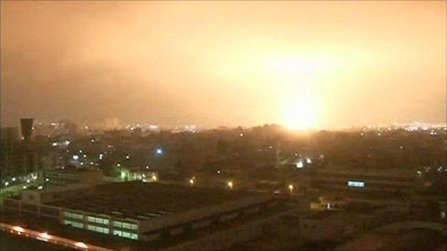 An explosion lights up the sky above Tripoli