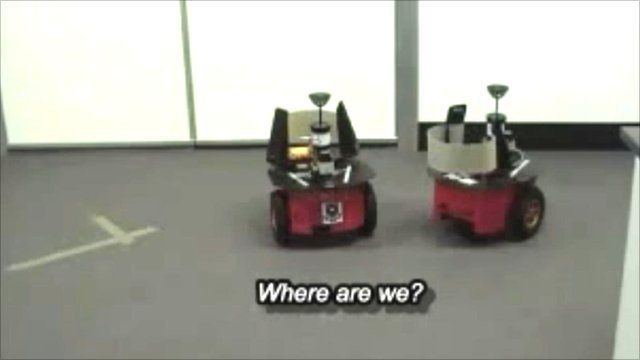 Robots playing a location language game