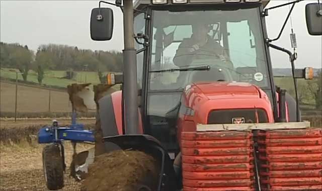 Tractor ploughing up wildlife margins on farm