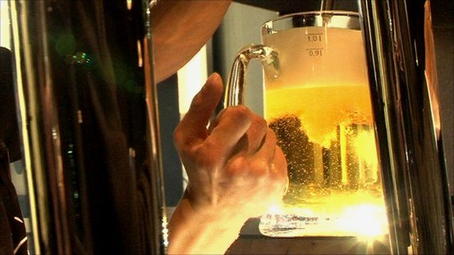 Beer being poured in bar
