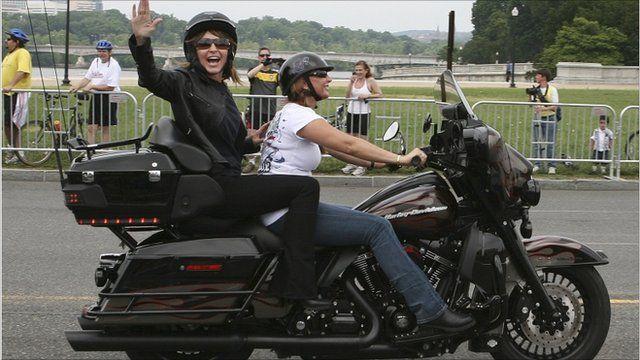 Sarah Palin on back of motorbike