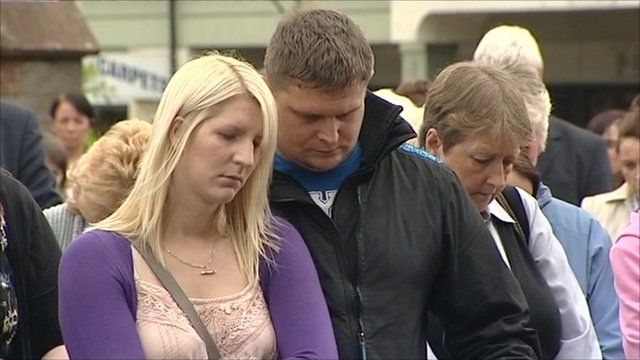 Couple observe minute silence