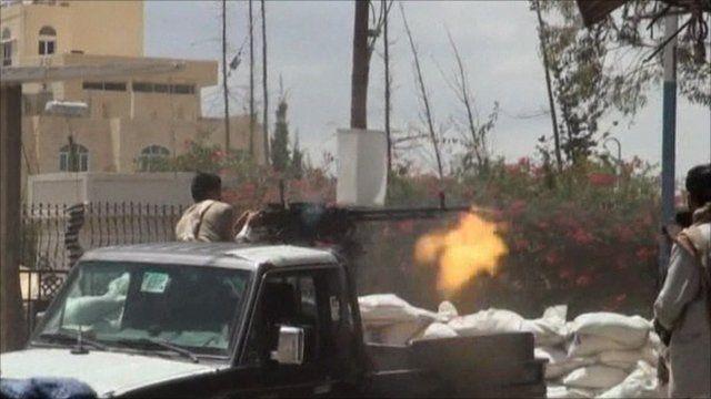 Man firing an automatic weapon