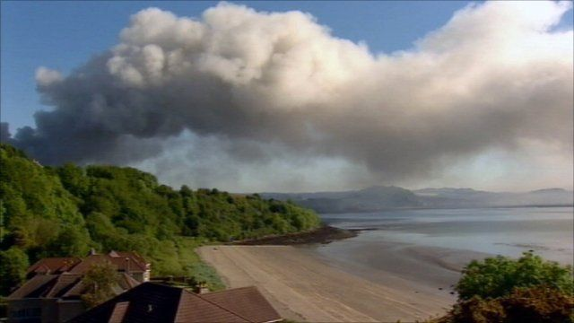 Smoke billows across the Forth estuary
