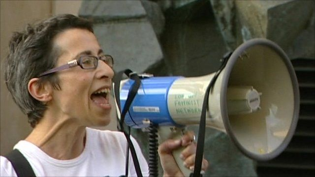 Protester uses loud hailer