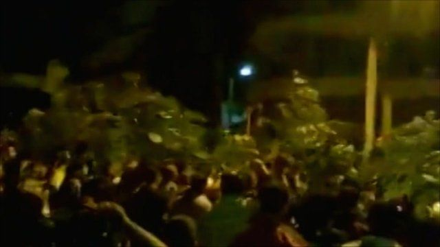 Unverified picture sent to BBC of people waving olive branches in Jisr al-Shughour