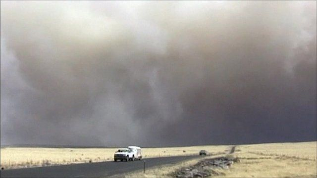 Car drives away from smoke