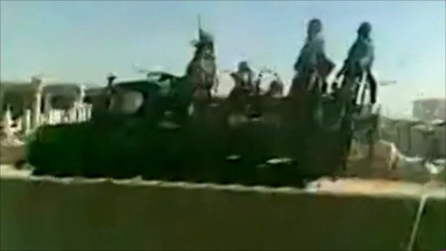 Syrian troops on back of vehicle