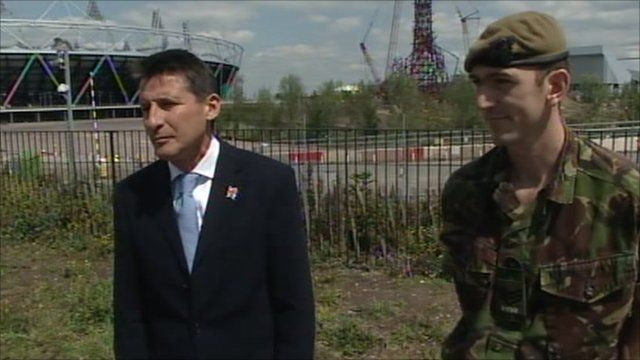 Lord Sebastian Coe, Chairman of London 2012, and Sergeant Chris Osborne from the Princess of Wales Royal Regiment
