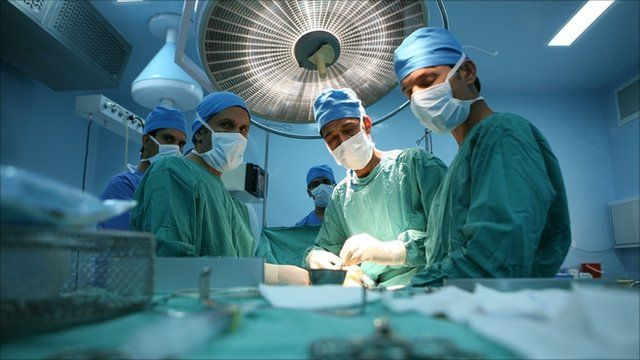 Doctors in operating theatre