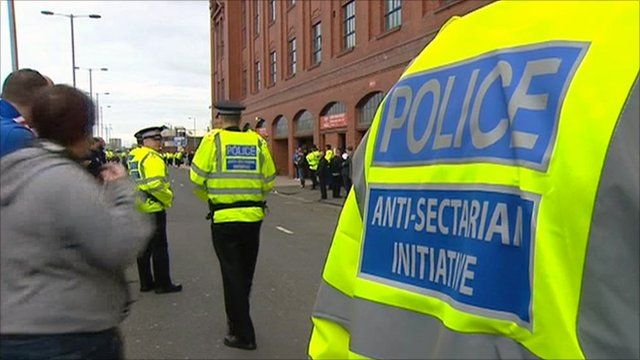 Police wearing anti-sectarian initiative jackets