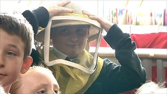 Student wearing beekeeping gear