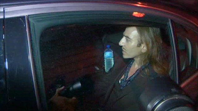 John Galliano leaving court in a car