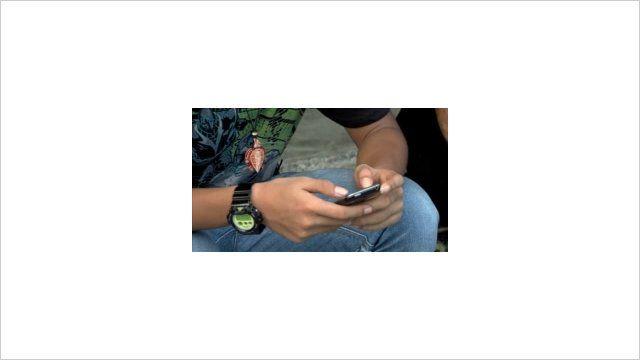 teenager holding smartphone