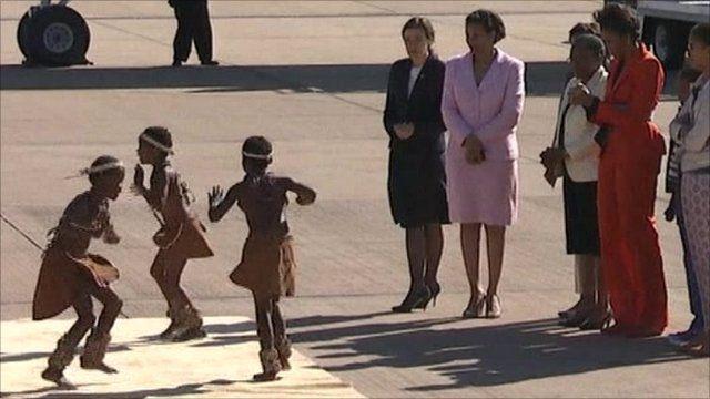 Dancers greet the Obamas in Botswana
